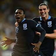 English forward Dany Welbeck (L) celebrates after scoring a goal during their Euro 2012 Group D match against Sweden, on June 15, at the Olympic Stadium in Kiev. England won 3-2