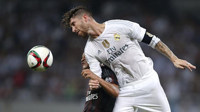 Carlos Bacca of AC Milan fights for the ball with Sergio Ramos of Real Madrid during their International Champions Cup soccer match in Shanghai