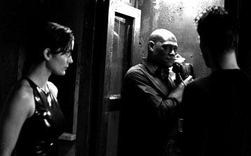 Carrie-Anne Moss , Laurence Fishburne and Keanu Reeves in Warner Brothers' The Matrix