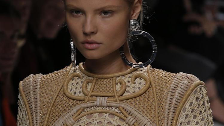 A model wears a creation by French designer Olivier Rousteing for Balmain's spring-summer 2013 ready to wear collection in Paris, Thursday, Sept. 27, 2012. (AP Photo/Francois Mori)