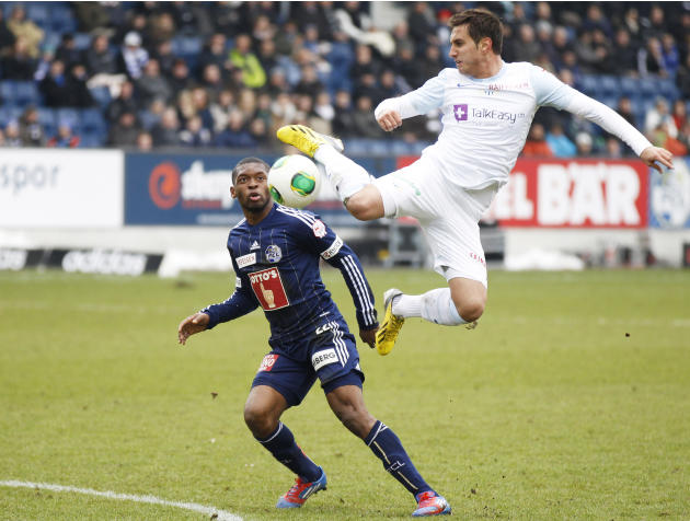 FC Luzern's Mounangue challenges FC Zurich's Gavranovic during their Swiss Super League soccer match in Lucerne