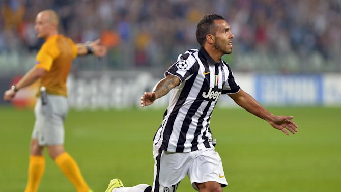 Juventus' Carlos Tevez celebrates after scoring his second goal during a Champions League, Group A soccer match between Juventus and Malmoe, at the Juventus Stadium in Turin, Italy, Tuesday, Sept. 16, 2014. (AP Photo/Massimo Pinca)