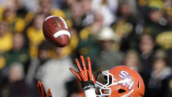 Sam Houston State's Tim Flanders (20) reaches up to grab a pass against North Dakota State during the first half of the FCS Championship NCAA college football game, Saturday, Jan. 5, 2013, in Frisco, Texas. (AP Photo/Tony Gutierrez)