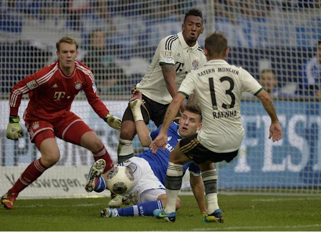 Schalke's Adam Szalai of Hungary, center, Bayern goalkeeper Manuel Neuer, left, Bayern's David Alaba of Austria and Rafinha of Brazil, right, challenge for the ball during the German soccer Bundesliga