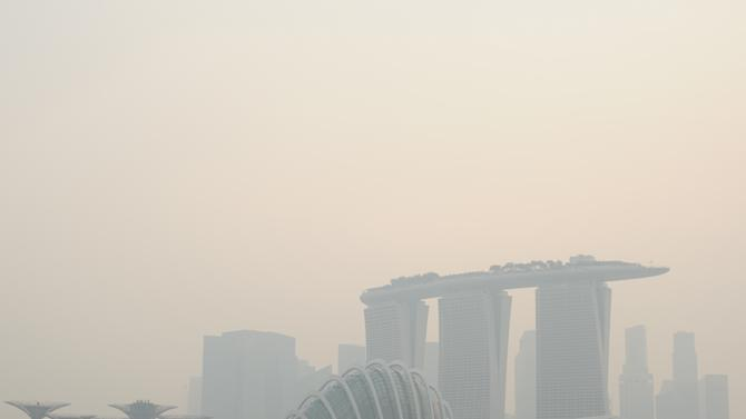 The Singapore skyline is shrouded in haze Friday, June 21, 2013. Air pollution in Singapore soared to record heights for a third consecutive day, as Indonesia dispatched planes and helicopters Friday to battle raging fires blamed for hazardous levels of smoky haze in three countries. (AP Photo/Joseph Nair)