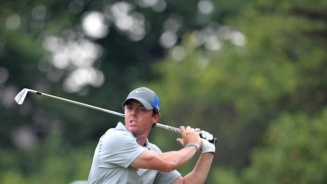 Northern Ireland's Rory McIlroy watches his shot on day 3 of the 2014 British Open Golf Championship at Royal Liverpool Golf Course in Hoylake, north west England on July 19, 2014