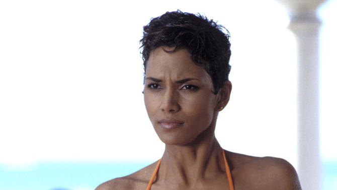 """This undated publicity photo provided by United Artists and Danjaq, LLC shows Halle Berry in a scene from the James Bond 2002 film, """"Die Another Day."""" Who qualifies as a Bond girl has also changed over the years, as the blue-eyed, buxom blonde has given way to more diverse leading ladies, including Michelle Yeoh (""""Tomorrow Never Dies"""") and Halle Berry (""""Die Another Day""""). Women use their presentation and their wiles to outsmart Bond. The film is included in the MGM and 20th Century Fox Home Entertainment Blu-Ray """"Bond 50"""" anniversary set. (AP Photo/United Artists and Danjaq, LLC)"""