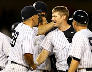 Chase Headley is congratulated by manager Joe Girardi after his winning hit. (Getty Images)