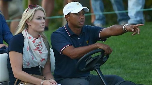 Skiier Lindsey Vonn waits with Tiger Woods during the Day One Four-Ball Matches at the Muirfield Village Golf Club (AFP)