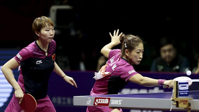 China's Liu and Zhu play against their compatriots Ding and Li in the women's doubles final table tennis match at the World Table Tennis Championships in Suzhou