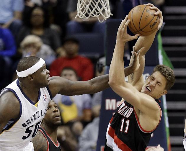 Portland Trail Blazers center Meyers Leonard (11) gets a hand in the face from Memphis Grizzlies forward Zach Randolph (50) in the first half of an NBA basketball game on Tuesday, March 11, 2014, in M