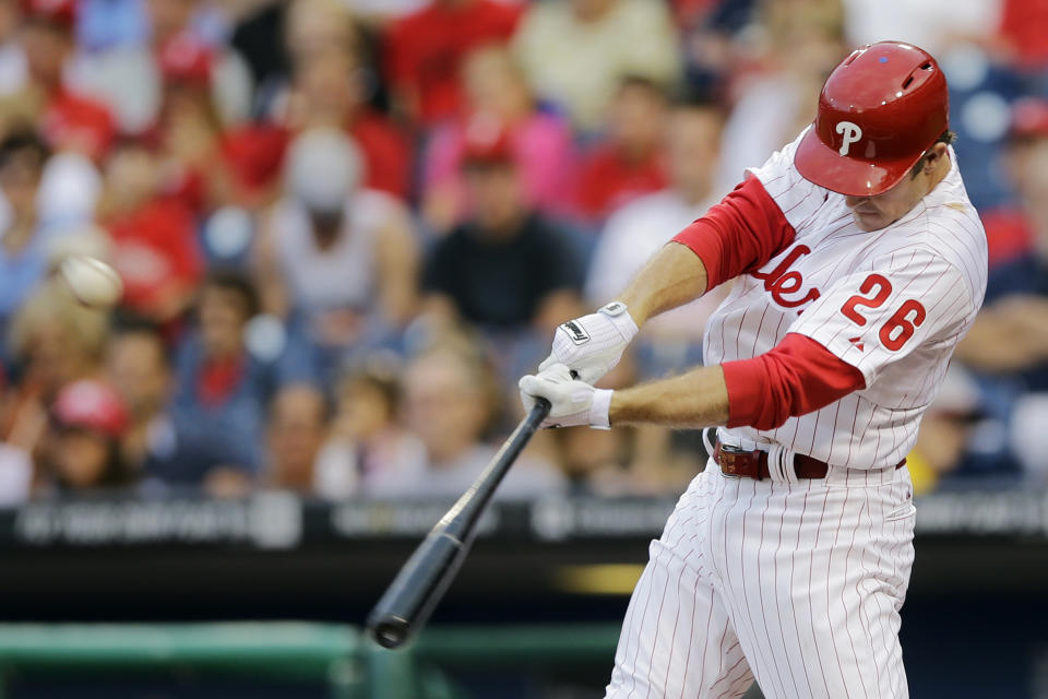 Philadelphia Phillies' Chase Utley hits an RBI-single off Chicago Cubs starting pitcher Edwin Jackson in the first inning of a baseball game, Tuesday, Aug. 6, 2013, in Philadelphia. (AP Photo/Matt Slocum)