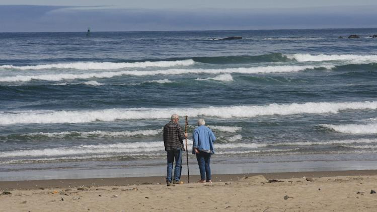 A couple walks along Bastendorff Beach Thursday, May 31, 2012, near Charleston, Ore. Thousands of people in three Oregon coastal communities are holding their first tsunami evacuation drill, stirred to action by the 2011 tsunami that devastated coastal towns in Japan. When the tsunami from Japan hit last year, residents had hours to get ready, and severe damage was limited to harbors such as Crescent City, Calif. One person was swept away and died. (AP Photo/Rick Bowmer)