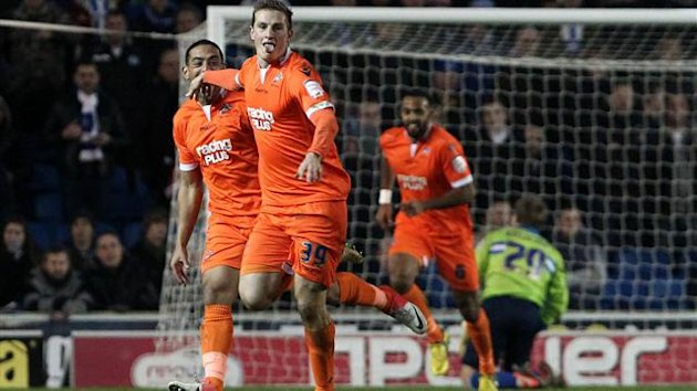 Chris Wood, centre, wheels away after scoring Millwall's second goal against Brighton