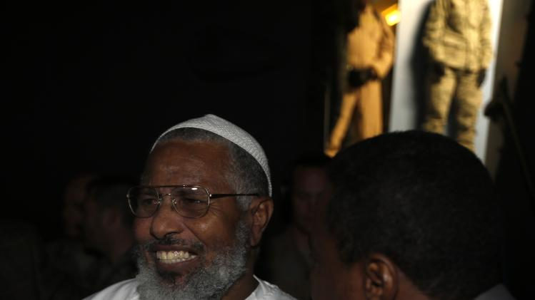 Sudanese Osman, one of two Sudanese detainees released from the Guantanomo facility in Cuba, smiles after disembarking from an U.S. Air Force plane at Khartoum Airport