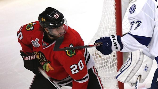 Brandon Saad (L) of the Chicago Blackhawks during Game Six of the NHL Stanley Cup Final against the Tampa Bay Lightning at the United Center on June 15, 2015