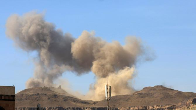 """In this photo take on Friday, April 17, 2015, smoke rises after a Saudi-led airstrike on Sanaa, Yemen.  Iran's foreign minister urged U.N. Secretary-General Ban Ki-moon on Friday to try to end """"the senseless aerial attacks"""" in Yemen by a Saudi-led coalition and establish a cease-fire.  (AP Photo/Shohdi Alsofi)"""