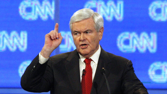 Former House Speaker Newt Gingrich scolds CNN moderator John King at the beginning of a Republican presidential candidates debate in Charleston