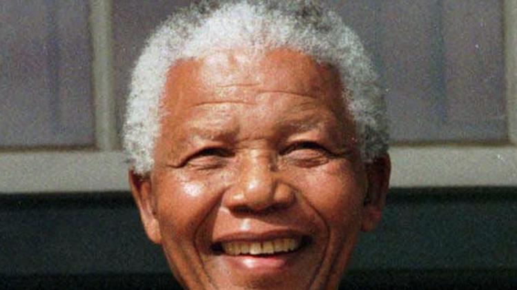 "FILE - In this May 11, 1999 file photo, South African President Nelson Mandela, is photographed in Cape Town, South Africa. Mandela, the former South African president and anti-apartheid leader, was admitted to a hospital on Saturday, March 9, 2013, for a scheduled medical check-up and doctors say there is no cause for ""alarm,"" the president's office said.  (AP Photo, File)"