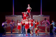 "This undated image provided by Joan Marcus shows a scene from ""Bring It On: The Musical"" in Denver. Producers announced Wednesday, May 16, 2012 that the show written by Lin-Manuel Miranda, Amanda Green and Tom Kitt will come to New York as part of the show's 13-city national tour. Its 12-week stand at the St. James Theatre is set to begin July 12 with an official opening of Aug. 1. (AP Photo/Joan Marcus)"