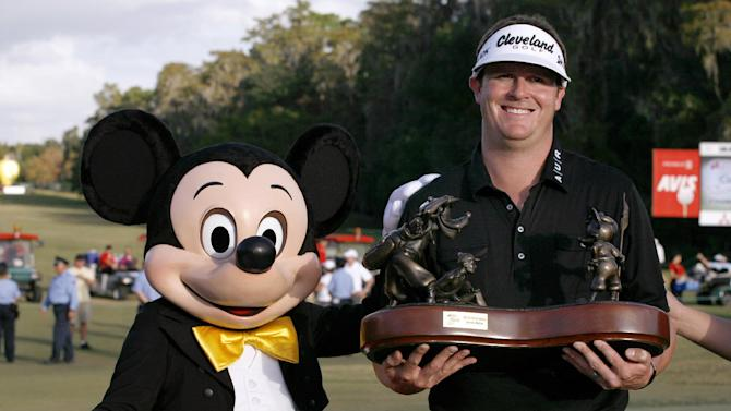 """Charlie Beljan, right, and """"Mickey Mouse"""" hold up the trophy on the 18th green following the final round of the Children's Miracle Network Hospitals golf tournament in Lake Buena Vista, Fla., Sunday, Nov. 11, 2012. (AP Photo/Reinhold Matay)"""