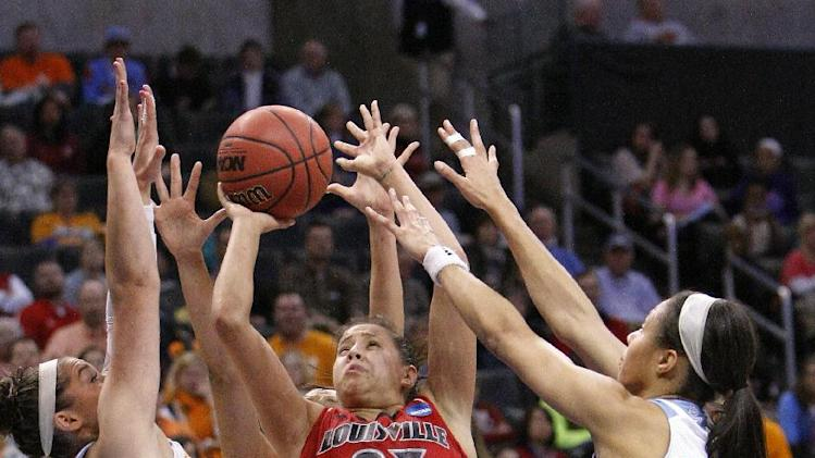 Louisville guard Shoni Schimmel, center, shoots between Tennessee's Taber Spani, left, and Isabelle Harrison, right, during the first half of the Oklahoma City regional final in the NCAA women's college basketball tournament in Oklahoma City, Tuesday, April 2, 2013. (AP Photo/Alonzo Adams)