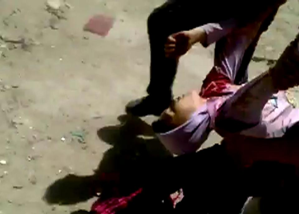 This image made from amateur video released by Shaam News Network and accessed Friday, May 25, 2012 purports to show a wounded child being evacuated in Aleppo, Syria. (AP Photo/Shaam News Network via AP video) TV OUT, THE ASSOCIATED PRESS CANNOT INDEPENDENTLY VERIFY THE CONTENT, DATE, LOCATION OR AUTHENTICITY OF THIS MATERIAL