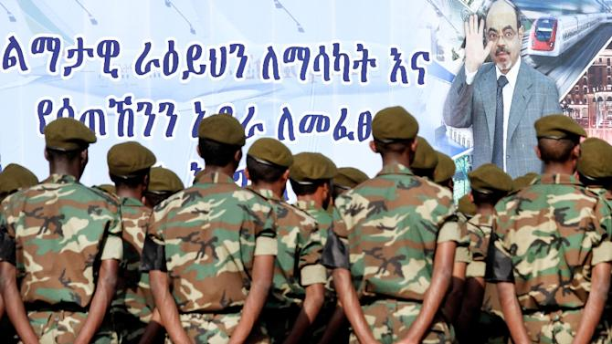 Ethiopian soldiers take part to the official state funeral of Ethiopia's late Prime Minister Meles Zenawi under a giant poster of late strongman in Addis Ababa on September 2, 2012