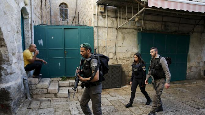 Israeli border policemen patrol the area in Jerusalem's old city