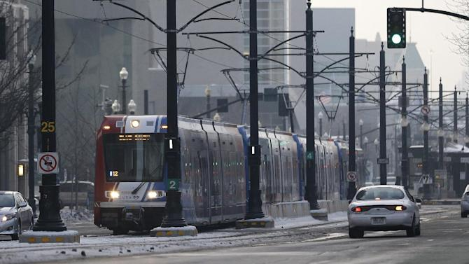 The light rail travels in downtown Salt Lake City Wednesday, Jan. 9, 2013. Built with the 2002 Winter Olympics in mind, Salt Lake City's light-rail network is free for passengers as it weaves through downtown. Riders can get to and from major attractions such as Temple Square, City Creek Center, Salt Lake City Library, Energy Solutions Arena and the Gateway for free.   (AP Photo/Rick Bowmer)