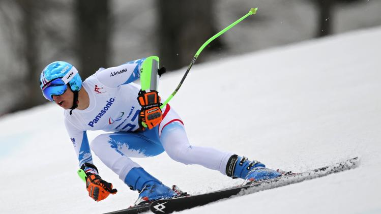 Austria's Markus Salcher skis to win the men's standing skiing Super G at the 2014 Sochi Paralympic Winter Games at the Rosa Khutor Alpine Center