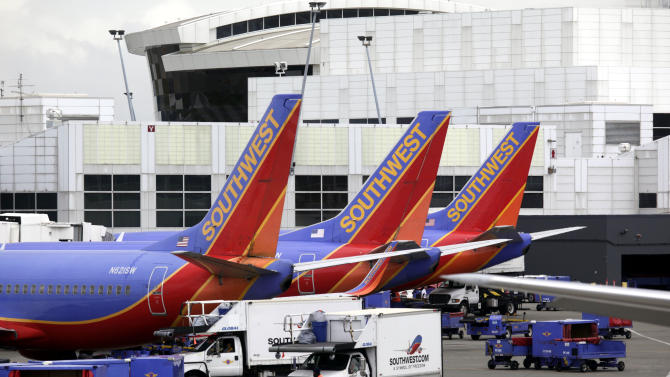 FILE - In this file photo taken June 7, 2010, Southwest Airlines planes are shown at Seattle-Tacoma International Airport in Seattle. (AP Photo/Ted S. Warren, File)