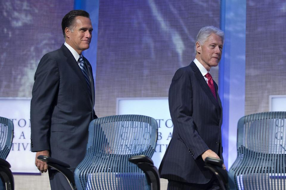 Former President Bill Clinton and Republican presidential candidate, former Massachusetts Gov. Mitt Romney arrive at the Clinton Global Initiative convention in New York, Tuesday, Sept. 25, 2012.  (AP Photo/ Evan Vucci)
