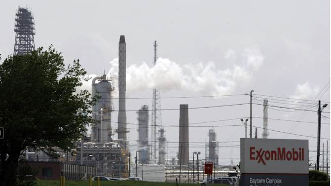 FILE - In this April 16, 2010 file  photo, steam rises from towers at an Exxon Mobil refinery in Baytown, Texas. Exxon says the energy renaissance in the U.S. will continue and predicts that North America will become a net exporter of oil and gas by the middle of the next decade.  The oil and gas giant's latest long-term energy outlook, released Tuesday, Dec. 11, 2012, says the rapid growth of production in the U.S., Canada along with improved energy efficiency will lead to more oil and gas being sent overseas.  (AP Photo/Pat Sullivan. File)