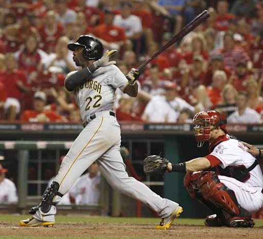 McCutchen's HRs rally Pirates over Reds 6-5 in 11
