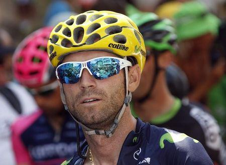 Movistar rider Valverde of Spain looks on as he waits the start of 19th stage of the Tour de France cycling race