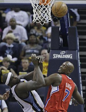 Memphis Grizzlies forward Zach Randolph (50) and Los Angeles Clippers' Lamar Odom (7) work for a rebound during the first half of Game 3 in a first-round NBA basketball playoff series, in Memphis, Tenn., Thursday, April 25, 2013. (AP Photo/Danny Johnston)