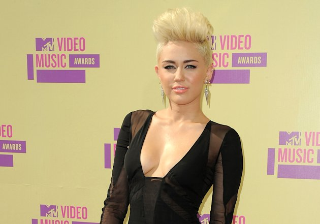 FILE - In this Sept. 6, 2012 file photo, Miley Cyrus attends the MTV Video Music Awards in Los Angeles. A judge granted Cyrus a three-year restraining order on Friday Nov. 16, 2012 against a man convicted of trespassing at the actress-singer&#39;s home and resisting arrest. (Photo by Jordan Strauss/Invision/AP, file)
