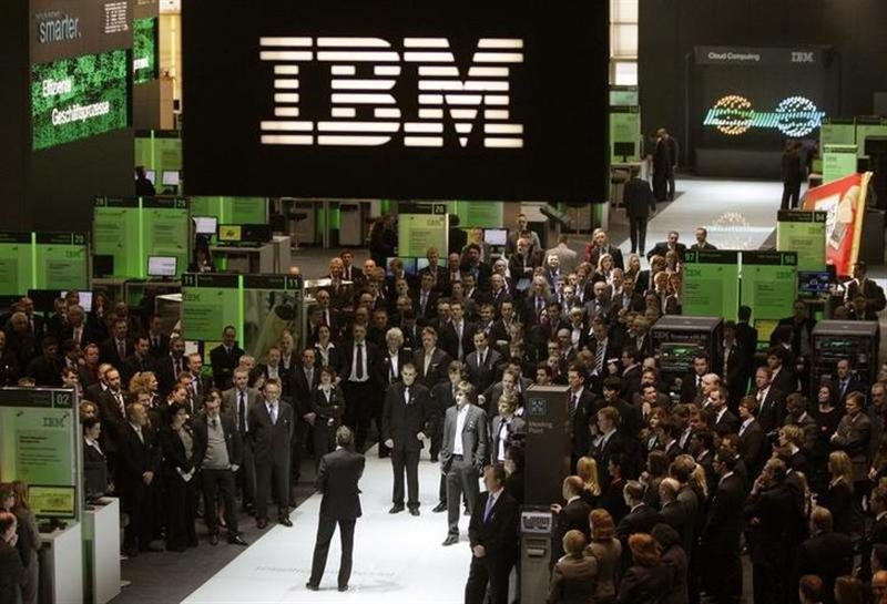 Employees follows a speech at the booth of IBM at CeBIT computer fair in Hanover March 3, 2009. REUTERS/Hannibal Hanschke