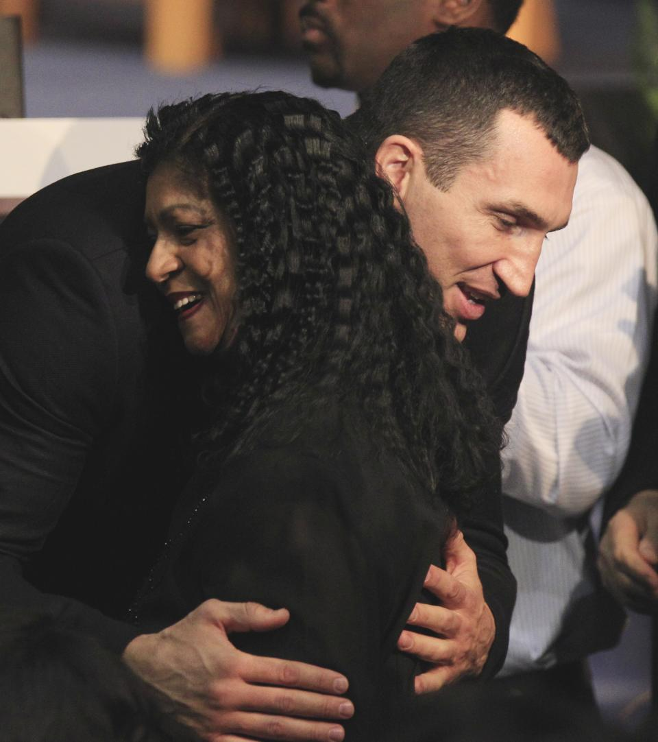 WBC Heavyweight Champion Vitali Klitschko hugs a member of the late boxing trainer Emanuel Steward's family at a funeral service for Steward at the Greater Grace Temple in Detroit, Tuesday, Nov. 13, 2012. (AP Photo/Carlos Osorio)