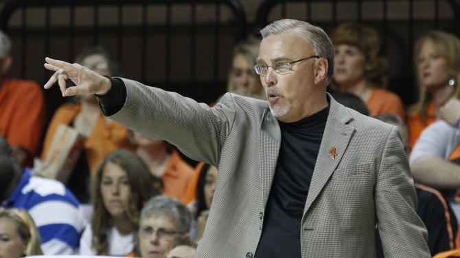Oklahoma State head coach Jim Littell directs his team in the first half of the WNIT Championship NCAA college basketball game against James Madison in Stillwater, Okla., Saturday, March 31, 2012. (AP Photo/Sue Ogrocki)