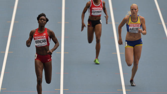 United States' Kimberlyn Duncan, Ghana's Janet Amponsah and Sweden's Moa Hjelmer, from left, compete in a women's 200-meter heat at the World Athletics Championships in the Luzhniki stadium in Moscow, Russia, Thursday, Aug. 15, 2013. (AP Photo/Martin Meissner)