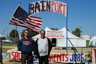 Sensata Technologies workers stand at the entrance to a protest camp called &#39;Bainport&#39; set up in Freeport, Illinois on September 19, 2012. The workers, whose jobs are being outsourced to China, want to illustrate what they say will happen to the United States if Mitt Romney wins the election. Sensata is owned by Bain Capital, a private equity group founded by Romney