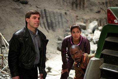Director Ron Underwood with Rosario Dawson and Eddie Murphy on the set of The Adventures of Pluto Nash