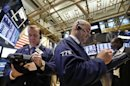 Wall Street sags after Fed comments, but Cisco surges