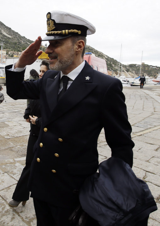 Italian Coast Guard Capt. Gregorio De Falco salutes as he arrives on the Tuscan Island Isola del Giglio, Italy, Sunday, Jan. 13, 2013.  De Falco was heard ordering the captain, who had abandoned the s