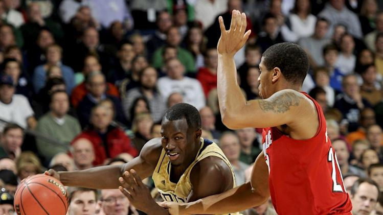 Notre Dame guard Jerian Grant, left, drives against Louisville guard Wayne Blackshear during the first half of an NCAA college basketball game, Saturday, Feb. 9, 2013, in South Bend, Ind. (AP Photo/Joe Raymond)