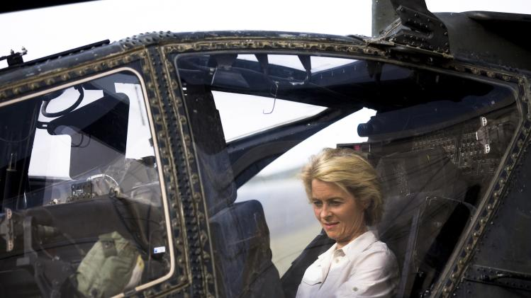 German Defence Minister Ursula von der Leyen sits in an AH-64D Apache helicopter during a demonstration of the air force equipment of various ISAF forces at Camp Marmal outside Mazar-i-Sharif