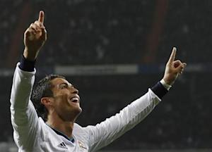 Real Madrid's Cristiano Ronaldo celebrates his second goal during their Spanish King's Cup soccer match against Celta Vigo at Santiago Bernabeu stadium in Madrid