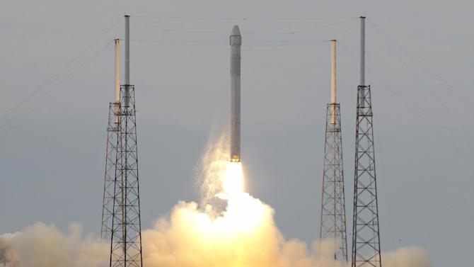 The Falcon 9 SpaceX rocket lifts off from launch complex 40 at the Cape Canaveral Air Force Station in Cape Canaveral, Fla. on Friday, March 1, 2013. The rocket is transporting the Dragon capsule to the International Space Station containing more than a ton of food, tools, computer hardware and science experiments. (AP Photo/John Raoux)
